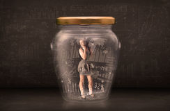 Businesswoman traped in jar with graph chart symbols concept Stock Photography