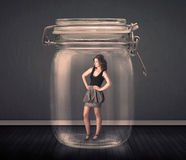 Businesswoman trapped into a glass jar concept Royalty Free Stock Images