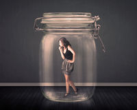 Businesswoman trapped into a glass jar concept Royalty Free Stock Image