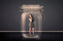 Businesswoman trapped into a glass jar concept Royalty Free Stock Photo