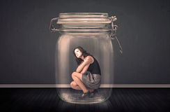Businesswoman trapped into a glass jar concept Stock Image