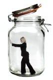 Businesswoman trapped. Businesswoman trapped inside a transparent glass jar Stock Image
