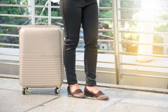 Businesswoman traveler with luggage Stock Images