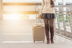 Businesswoman traveler with luggage at city Royalty Free Stock Photos