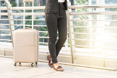 Businesswoman traveler with luggage at city background. Royalty Free Stock Images