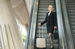 Businesswoman traveling with bags Stock Photography