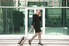 Businesswoman traveling and calling with mobile phone Royalty Free Stock Photography