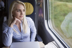 Businesswoman traveling by train Royalty Free Stock Photography
