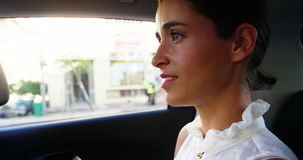 Businesswoman travelling in car stock video footage