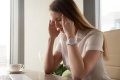 Businesswoman tries to cope with nervous tension. Or anxiety. Woman suffering from panic attacks or head ache. Girl in depression because of troubles at work stock photo