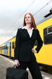 Businesswoman on Trip. A confident young Caucasian business woman at a train station Stock Photography