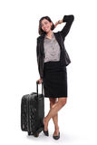 Businesswoman on a trip, full body pose. Full length portrait of attractive Asian business woman standing pose with a black suitcase, isolated on white Stock Images