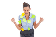 Businesswoman triumphing with adhesive notes Stock Photos