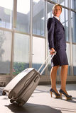 Businesswoman with trolley. At the airport Royalty Free Stock Photography