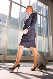 Businesswoman with trolley. At the airport Stock Photo