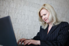 Businesswoman trolling in office Stock Images