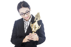 Businesswoman with trophy Stock Images