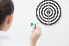 Businesswoman trying hit bullseye Stock Photography