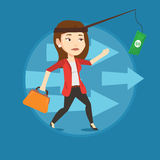 Businesswoman trying to catch money on fishing rod Stock Photo