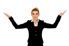 Businesswoman trying to catch something Royalty Free Stock Photos