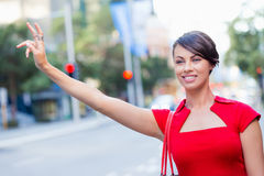 Businesswoman trying to catch a taxi Stock Photo