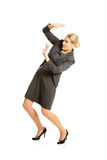 Businesswoman trying to protect herself Stock Image