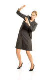 Businesswoman trying to protect herself Royalty Free Stock Photography