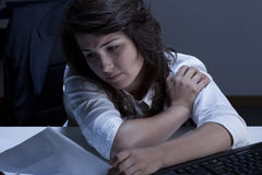 Businesswoman trying to resolve problem. Tired and sleepy businesswoman trying to resolve problem Stock Photo