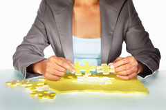 Businesswoman trying to solve the puzzle Stock Image