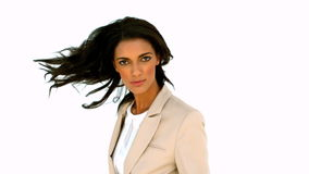Businesswoman turning and looking at the camera. In slow motion stock video