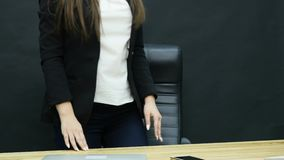 Businesswoman turning off her laptop, she is going home, end of work day concept.  stock footage
