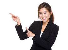 Businesswoman with two finger point up Royalty Free Stock Photos