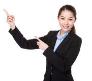 Businesswoman with two finger point up Stock Photography