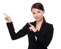 Businesswoman with two hand point up Stock Photos