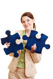 Businesswoman with two jigsaw Stock Images