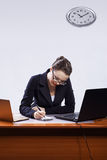 Businesswoman with two laptops Stock Photo
