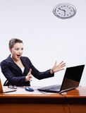 Businesswoman with two laptops Royalty Free Stock Photos