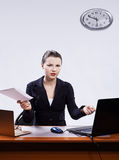 Businesswoman with two laptops Stock Photography