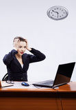 Businesswoman with two laptops Stock Images