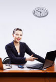 Businesswoman with two laptops Stock Photos