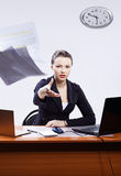 Businesswoman with two laptops Stock Image