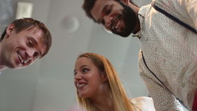 Businesswoman and two male colleagues discussing documents and business plan. Low angle close up of businesswoman and two male colleagues discussing documents stock footage