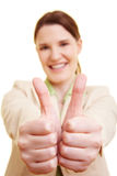 Businesswoman with two thumb up Stock Images