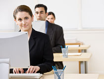 Businesswoman typing on computer Stock Photography