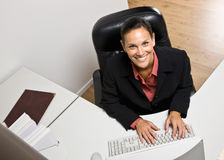 Businesswoman typing on computer. Businesswoman typing on a computer Royalty Free Stock Image