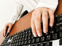 Businesswoman typing in the computer Stock Images