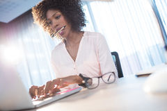 Businesswoman typing on her computer Stock Images