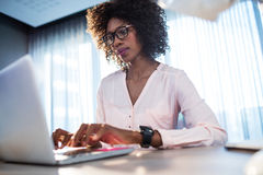 Businesswoman typing on her computer Stock Image