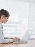 Businesswoman typing on her laptop at desk Royalty Free Stock Photography