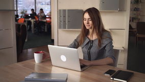 A businesswoman typing on her laptop at working office place stock footage